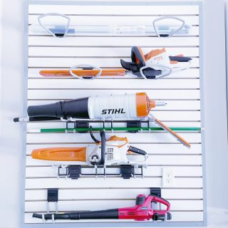 Our number one tip for organizing a garage is to use vertical space and one of our favorite ways to do that is a slat wall 🛠 It keeps everything up off the floor and easy to access 💯