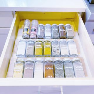 A few little changes can make a huge difference!  We transformed this spice drawer by tossing expired spices, transferring spices to matching jars and adding handwritten labels 💯   Swipe to see the before!