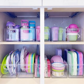 Have you ever seen a more perfectly organized kids' cabinet? We stored items in a lower cabinet for easy access and contained like-items in @mdesign deep drawer bins.